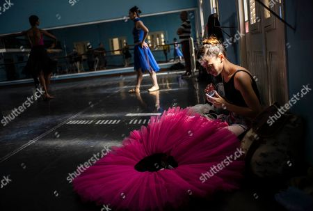 A dancer of the national ballet of Cuba prepares to rehearse a play in Havana, Cuba, . The Soviet-style system that recruits children into a system of increasingly selective state dance schools has produced hundreds of elite dancers including Lorna Feijóo, Rolando Sarabia, Taras Domitro, Anette Delgado and Carlos Acosta