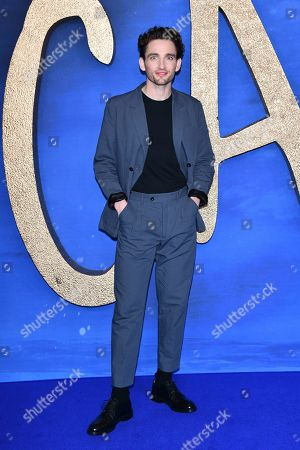 Laurie Davidson poses for photographers upon arrival at the photo call for the film 'Cats', at a central London hotel