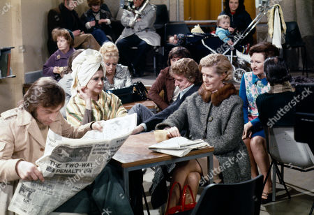 Residents are evacuated to the Community Centre due to a large water pipe leak in the street. Kenneth Farrington (as Billy Walker), Jean Alexander (as Hilda Ogden), Julie Goodyear (as Bet Lynch), Peter Adamson (as Len Fairclough), Irene Sutcliffe (as Maggie Clegg) and Eileen Derbyshire (as Emily Bishop)