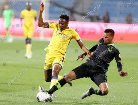 Al-Nassr's Ahmed Musa (L) in action against Al-Taawoun's Ahmed Assiri (R) during the Saudi Professional League soccer match between Al- Nassr and Al-Taawoun at Prince Faisal bin Fahd Stadium, Al-Riyadh, Saudi Arabia, 13 December 2019.