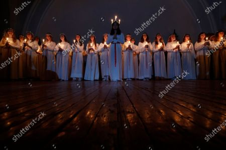 Students of the Department of Scandinavian languages of St. Petersburg state University take part in the feast day of St. Lucia in the Swedish Church of St. Catherine in St. Petersburg, Russia, 13 December 2019. Sweden and the regions of Finland, where many Swedish people live, celebrate a beautiful holiday-St. Lucia Day. Lucia represents the light that is sure to return after the long and dark Northern winter.