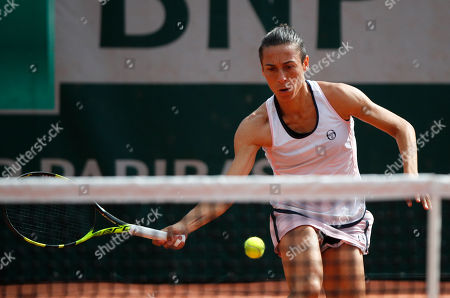 Italy's Francesca Schiavone returns the ball during the French Open tennis tournament at the Roland Garros Stadium in Paris. Former French Open champion Francesca Schiavone has revealed that she overcame a battle with cancer