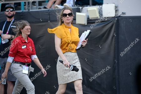 FOX Sports sideline reporter Jennifer Hale walks on the field during the first half of an NFL football game between the Jacksonville Jaguars and the Tampa Bay Buccaneers, in Jacksonville, Fla