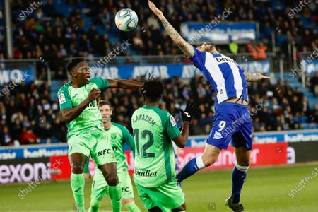 Stock Photo of Leganes' defender Kenneth Omeruo (L), from Nigeria, fights for the ball against Alaves' Joselu (R) during the Spanish LaLiga match between Deportivo Alaves and CD Leganes at Mendizorroza stadium in Vitoria, Basque Country, Spain, 13 December 2019.