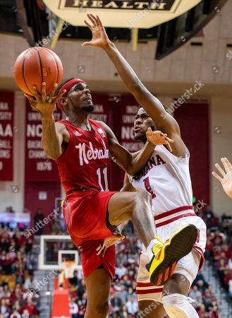 Nebraska guard Dachon Burke Jr. (11) drives to the basket as he is defended by Indiana guard Al Durham (1) during the second half of an NCAA college basketball game, in Bloomington, Ind