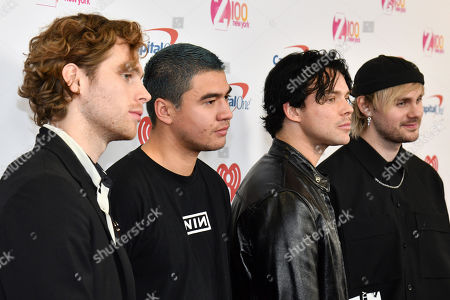 Luke Hemmings, Calum Hood, Ashton Irwin, Michael Clifford. Luke Hemmings, left, Calum Hood, Ashton Irwin and Michael Clifford from the band 5 Seconds of Summer attend Z100's iHeartRadio Jingle Ball at Madison Square Garden, in New York