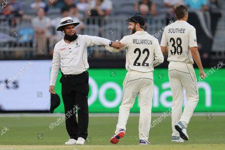 Aleem Dar, Kane Williamson. Umpire Aleem Dar, left, laughs with New Zealand skipper Kane Williamson after Dar was injured when bowler Mitchell Santner ran into him during play in their cricket test against Australia in Perth, Australia