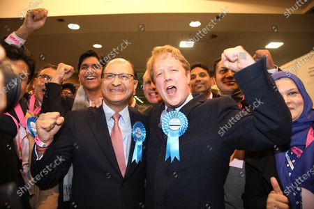 Stock Picture of Paul Bristow (Conservative), wins the Peterborough seat from Lisa Forbes (Labour), and celebrates with North West Cambridgeshire's Shailesh Vara.