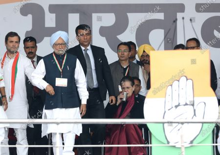 Former Prime Minister of India Manmohan Singh (2-L) arrives on stage during the anti-government Bharat Bachao (Save India) rally at Ramlila Maidan in New Delhi, India, 14 December 2019.