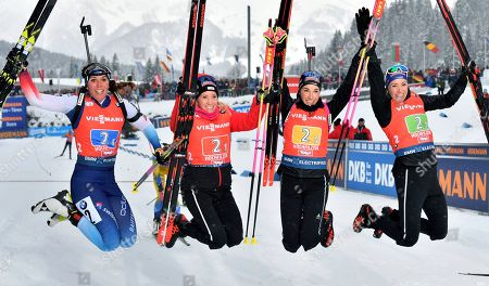 Stock Image of From left, team Switzerland's Lena Haecki, Elisa Gasparin, Aita Gasparin and Selina Gasparin celebrate after the women's 4x6 km relay competition at the Biathlon World Cup in Hochfilzen, Austria