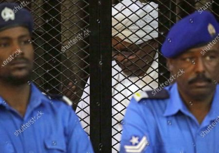 Sudan's ousted president Omar Hassan al-Bashir sits in the defendant's cage during his trial in Khartoum, Sudan, 14 December 2019. A Sudanese court in Khartoum on 14 December 2019 found former president al-Bashir guilty of money laundering and sentenced him to two years in rehabilitation facility. The verdict is the first in several cases against al-Bashir who was ousted in April 2019 after some 30 years in power.