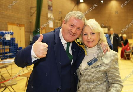 Ian Blackford the SNP leader at Westminster celebrates with his wife Ann at the election count in Inverness