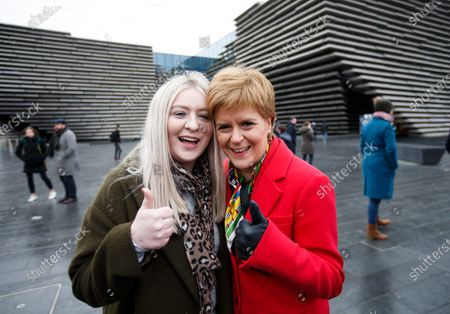 SNP leader Nicola Sturgeon (R) with Amy Callaghan (L), who won the East Dunbartonshire seat from Liberal Democrat leader Jo Swinson, joins the Scottish National Party SNP's newly elected MPs for a group photo outside the V&A Museum in Dundee, Scotland, Britain, 14 December 2019.