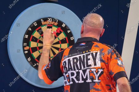 Raymond van Barneveld (Netherlands), during his First Round match against Darin Young (USA) (not in picture), evening session of Day Two in the PDC William Hill World Darts Championship at Alexandra Palace, London
