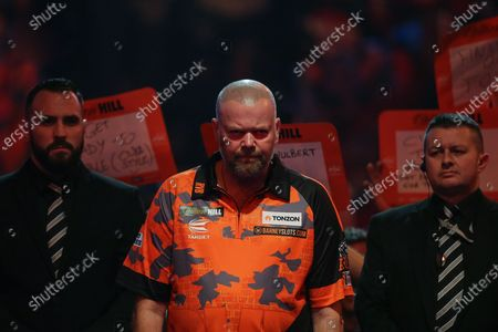 Raymond van Barneveld (Netherlands), walk-on, before his First Round match against Darin Young (USA) (not in picture), evening session of Day Two in the PDC William Hill World Darts Championship at Alexandra Palace, London