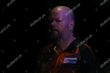 Raymond van Barneveld (Netherlands) in the shadows before his walk-on for his First Round match against Darin Young (USA) (not in picture), evening session of Day Two in the PDC William Hill World Darts Championship at Alexandra Palace, London