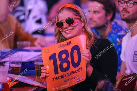 """Fans holding """"180 Barney Army"""" signs during the evening session of Day Two in the PDC William Hill World Darts Championship at Alexandra Palace, London"""