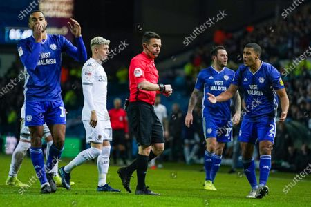 Stock Image of Cardiff City defender Lee Peltier (2) reacts to Tony Harrington (Referee) showing Cardiff City defender Sean Morrison (4) a red card during the EFL Sky Bet Championship match between Leeds United and Cardiff City at Elland Road, Leeds