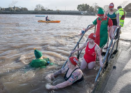 Stock Photo of Homeless charity Crisis holds its first Icebreaker Challenge in the Bristol area, with fundraisers in fancy dress swimming in the cold waters of Clevedon's Marine Lake. The event was opened by adventurer and outdoor swimmer Lindsey Cole, who this December is walking along the south coast path to Bristol, encouraging others to join her swimming in the sea for the homeless. Crisis is a national charity for homeless people which helps people directly out of homelessness and campaigns for the social changes needed to solve it altogether. Crisis provides services across Britain with help for people experiencing homelessness all year round.