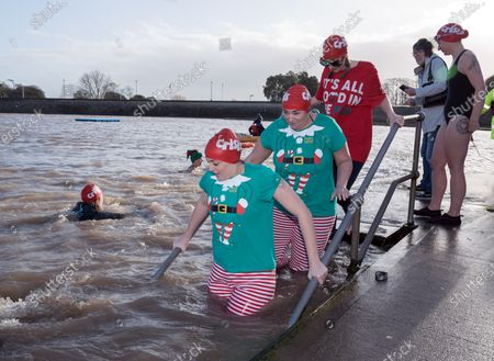 Stock Picture of Homeless charity Crisis holds its first Icebreaker Challenge in the Bristol area, with fundraisers in fancy dress swimming in the cold waters of Clevedon's Marine Lake. The event was opened by adventurer and outdoor swimmer Lindsey Cole, who this December is walking along the south coast path to Bristol, encouraging others to join her swimming in the sea for the homeless. Crisis is a national charity for homeless people which helps people directly out of homelessness and campaigns for the social changes needed to solve it altogether. Crisis provides services across Britain with help for people experiencing homelessness all year round.