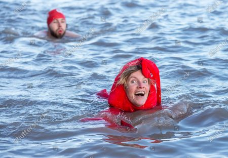 Stock Image of Lindsey Cole dressed as a lobster swims as part of the Icebreaker challenge to raise money for homeless charity Crisis holding its first Icebreaker Challenge in the Bristol area, with fundraisers in fancy dress swimming in the cold waters of Clevedon's Marine Lake. The event was opened by adventurer and outdoor swimmer Lindsey Cole, who this December is walking along the south coast path to Bristol, encouraging others to join her swimming in the sea for the homeless. Crisis is a national charity for homeless people which helps people directly out of homelessness and campaigns for the social changes needed to solve it altogether. Crisis provides services across Britain with help for people experiencing homelessness all year round.
