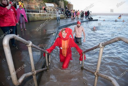 Stock Photo of Lindsey Cole dressed as a lobster swims as part of the Icebreaker challenge to raise money for homeless charity Crisis holding its first Icebreaker Challenge in the Bristol area, with fundraisers in fancy dress swimming in the cold waters of Clevedon's Marine Lake. The event was opened by adventurer and outdoor swimmer Lindsey Cole, who this December is walking along the south coast path to Bristol, encouraging others to join her swimming in the sea for the homeless. Crisis is a national charity for homeless people which helps people directly out of homelessness and campaigns for the social changes needed to solve it altogether. Crisis provides services across Britain with help for people experiencing homelessness all year round.