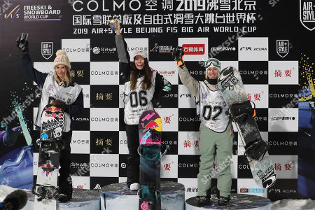 Winners of the Women's Snowboard Big Air from left Austria's Anna Gasser, runner up, Japan's Miyabi Onitsuka, who finished first and Canada's Laurie Blouin, second runner-up celebrate on the podium after the 2019 FIS Big Air World Cup held at the Big Air Shougang in Beijing