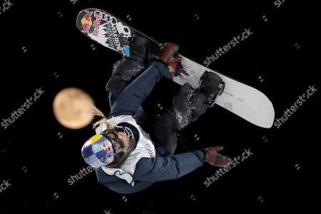 Austria's Anna Gasser jumps, backdropped by the moon, during the Women's Snowboard Big Air in the 2019 FIS Big Air World Cup held at the Big Air Shougang in Beijing on