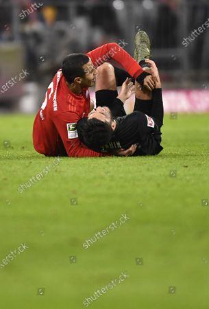 Bayern's Thiago (L) and Bremen's Nuri Sahin react during the German Bundesliga soccer match between FC Bayern Munich and SV Werder Bremern in Munich, Germany, 14 December 2019.
