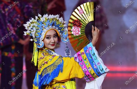 Miss China Li Peishan performs during the Miss World 2019 final in the Excel centre in London, Britain, 14 December 2019. The annual Miss World competition returns to London for its 69th year.