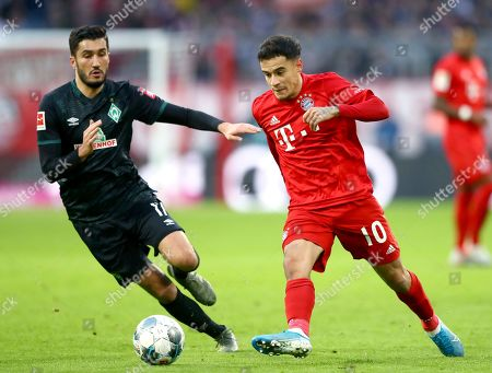 Bremen's Nuri Sahin, left, Bayern's Philippe Coutinho, right, challenge for the ball during the German Bundesliga soccer match between FC Bayern Munich and SV Werder Bremen in Munich, Germany