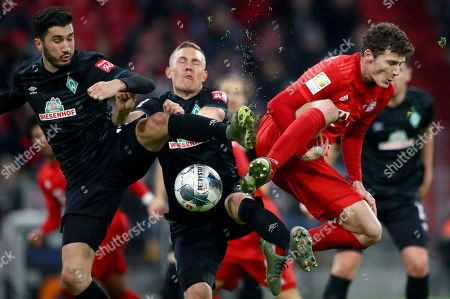 Bremen's Nuri Sahin, left, and Bayern's Benjamin Pavard, right, challenge for the ball during the German Bundesliga soccer match between FC Bayern Munich and SV Werder Bremen in Munich, Germany