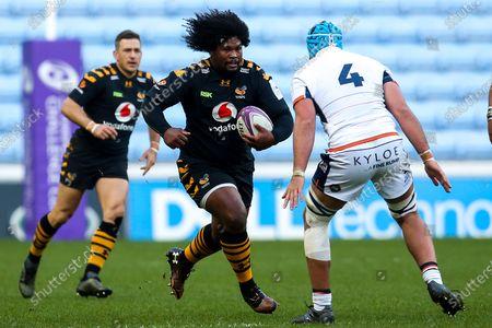 Stock Image of Ashley Johnson of Wasps takes on Sam Thomson of Edinburgh Rugby