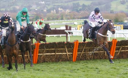 Call Me Lord and James Bowen [centre] wins the Unibet International Hurdle at Cheltenham from stable companion Pentland Hills [right] and Ch'Tibello [left] at Cheltenham.