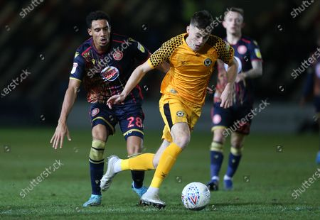 Lewis Collins of Newport County is challenged by Kurtis Guthrie of Stevenage.