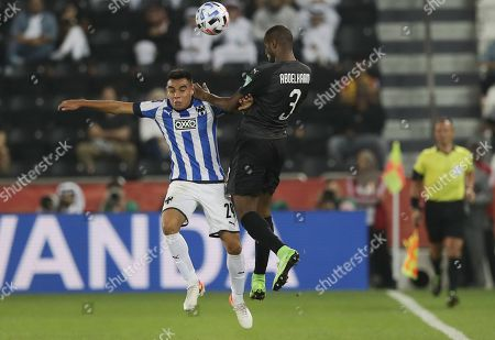 Monterrey's Carlos Rodriguez, left, and Al-Sadd's Abdelkarim Hassan jump for the ball during the Club World Cup soccer match between Monterrey and Al-Sadd at Jassim Bin Hamad Stadium in Doha, Qatar