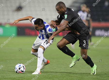Monterrey's Carlos Rodriguez, left. and Al-Sadd's Abdelkarim Hassan fight for the ball during the Club World Cup soccer match between Monterrey and Al-Sadd at Jassim Bin Hamad Stadium in Doha, Qatar
