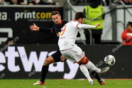 Duesseldorf's Dawid Kownacki shoots on goal and hits the bar during the German Bundesliga soccer match between Fortuna Duesseldorf and RB Leipzig in Duesseldorf, Germany