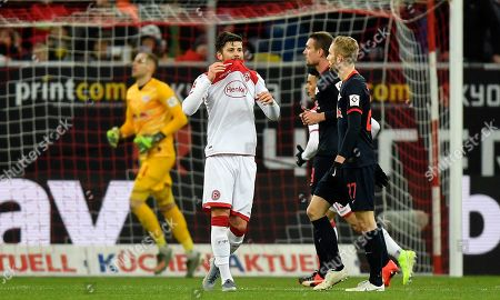 Duesseldorf's Dawid Kownacki reacts after his shot hits the bar during the German Bundesliga soccer match between Fortuna Duesseldorf and RB Leipzig in Duesseldorf, Germany