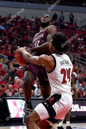 Stock Picture of Louisville forward Dwayne Sutton (24) strips the ball away from Eastern Kentucky guard Ty Taylor II (12) as he goes in for a layup during the first half of an NCAA college basketball game in Louisville, Ky