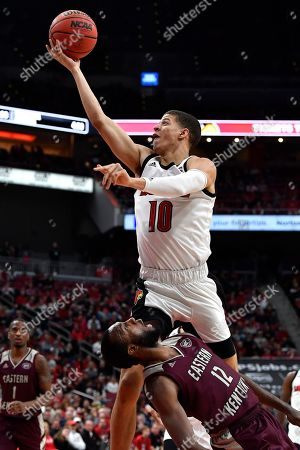 Louisville guard Samuell Williamson (10) goes in for a layup over the defense of Eastern Kentucky guard Ty Taylor II (12) during the second half of an NCAA college basketball game in Louisville, Ky., . Louisville won 99-67
