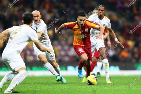 Stock Picture of Galatasaray's Radamel Falcao (C) in action against Ankaragucu's Michal Pazdan (L) during the Turkish Super League soccer match between Galatasaray Istanbul and MKE Ankaragucu in Istanbul, Turkey, 14 December 2019.