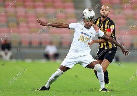 AL-Ittihad's Karim EL Ahmadi (R) in action against Al-Faisaly's William (L) during the Saudi Professional League soccer match between AL-Ittihad and Al-Faisaly at King Abdullah Sports City Stadium, Jeddah, Saudi Arabia, 14 December 2019.