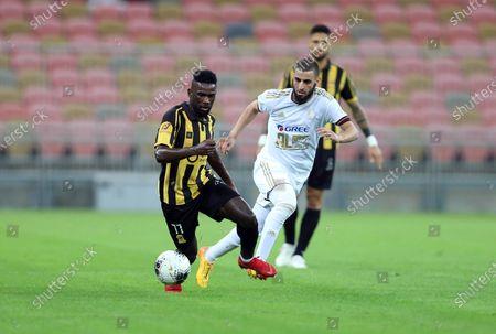 AL-Ittihad's Abdulaziz Al Bishi (L) in action against Al-Faisaly's Youssef El Jebli (R) during the Saudi Professional League soccer match between AL-Ittihad and Al-Faisaly at King Abdullah Sports City Stadium, Jeddah, Saudi Arabia, 14 December 2019.