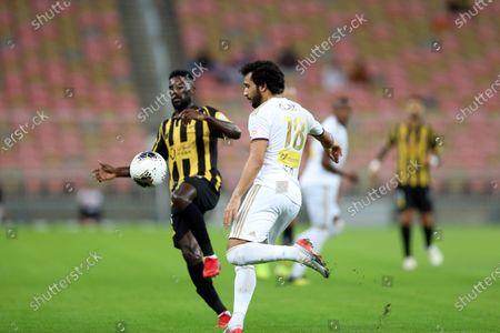 AL-Ittihad's Abdulaziz Al Bishi (L) in action against Al-Faisaly's Mohammed Qasem (R) during the Saudi Professional League soccer match between AL-Ittihad and Al-Faisaly at King Abdullah Sports City Stadium, Jeddah, Saudi Arabia, 14 December 2019.