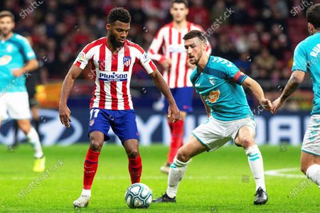Atletico Madrid's Thomas Lemar (L) in action against Osasuna's Oier Sanjurjo (R) during the Spanish La Liga match soccer between Atletico Madrid and CA Osasuna at Metropolitano stadium in Madrid, Spain, 14 December 2019.