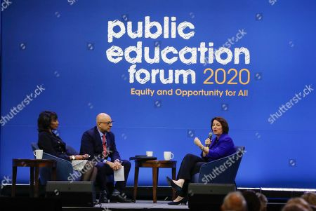 Democratic presidential candidate Sen. Amy Klobuchar, D-Minn., one of seven scheduled Democratic candidates participating in a public education forum, answers a question from Ali Velshi, center, and Rehema Ellis, left, in Pittsburgh. Topics at the event planned for discussion ranged from student services and special education to education equity and justice issues