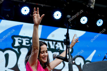 """Mexican singer-songwriter Julieta Venegas performs during the """"Girl Power"""" festival in Buenos Aires, Argentina, . The festival, organized by feminist groups seeking to redress male domination of music festivals, features female solo artists or women-fronted bands with a majority of women handling behind-the-scenes production"""