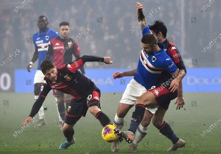 Sampdoria's Karol Linetty (C) in action against Genoa players Lasse Schone (L) and Francesco Cassata (R) during the Italian Serie A soccer match between Genoa CFC and UC Sampdoria at the Luigi Ferraris stadium in Genoa, Italy, 14 December 2019.