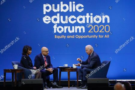 Democratic presidential candidate former Vice President Joe Biden, one of seven scheduled Democratic candidates participating in a public education forum, answers a question from Ali Velshi, center, and Rehema Ellis, left, in Pittsburgh. Topics at the event planned for discussion ranged from student services and special education to education equity and justice issues